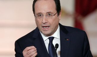 "** FILE ** In this Tuesday, Jan. 14, 2014, file photo, French President Francois Hollande delivers his speech at his annual news conference, at the Elysee Palace in Paris. Authorities say the mother of a pupil at a French preschool stabbed a teacher to death in front of her class Friday, July 4, 2014, the last day of the school year. Hollande expressed outrage at ""this abominable drama"" at the Edouard Herriot school in Albi in southern France. (AP Photo/Christophe Ena, File)"