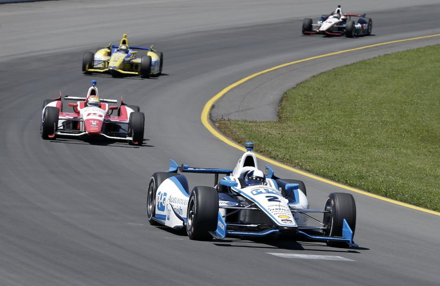 Juan Pablo Montoya, (2) of Colombia, drives during a practice session for Sunday's Pocono IndyCar 500 auto race, Saturday, July 5, 2014, in Long Pond, Pa. (AP Photo/Mel Evans)