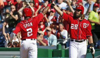 Washington Nationals' Denard Span (2) celebrates after scoring with teammate Jayson Werth during the third inning of a baseball game against the Chicago Cubs at Nationals Park, Saturday, July 5, 2014, in Washington. (AP Photo/Alex Brandon)