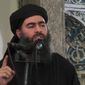 ** FILE ** Abu Bakr al-Baghdadi, the shadowy leader of the Islamic State, delivers a sermon posted on social media outlets that the militants use. (Associated Press)