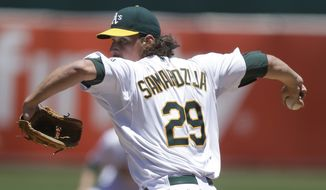 Oakland Athletics' Jeff Samardzija works against the Toronto Blue Jays in the first inning of a baseball game Sunday, July 6, 2014, in Oakland, Calif. (AP Photo/Ben Margot)