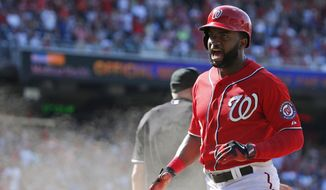 Washington Nationals' Denard Span celebrates after scoring the winning run during the eighth inning of a baseball game against the Chicago Cubs at Nationals Park, Sunday, July 6, 2014, in Washington. The Nationals won 2-1. (AP Photo/Alex Brandon)