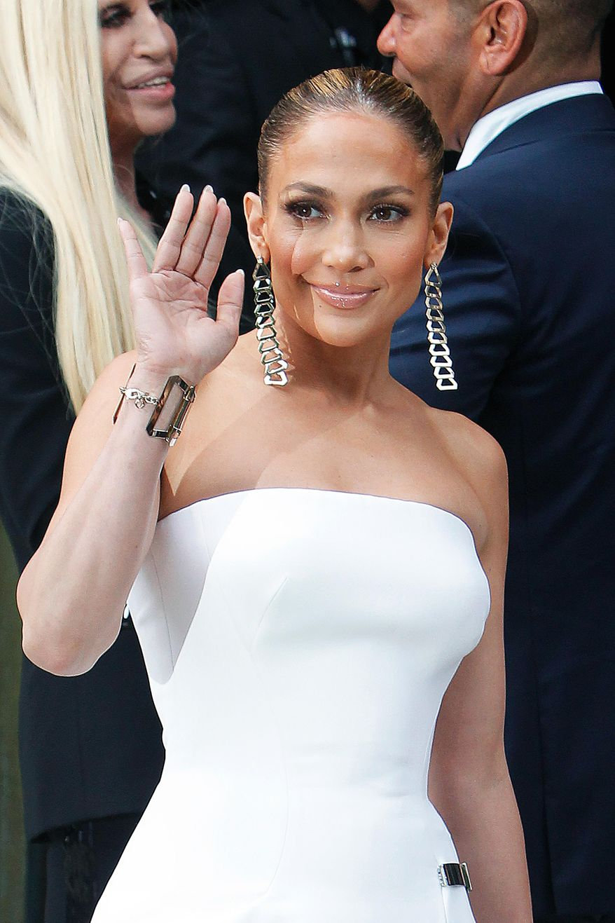 Singer Jennifer Lopez waves as she arrives for the Atelier Versace Fall Winter 2014-15  Haute Couture fashion collection, presented in Paris, Sunday, July 6, 2014. (AP Photo/Thibault Camus)