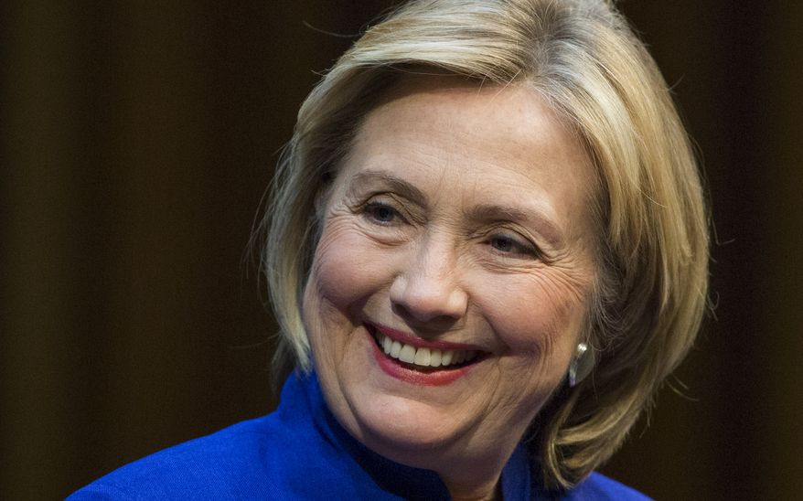 ** FILE ** Former U.S. Secretary of State Hillary Rodham Clinton smiles during a book launch in Berlin, Germany, Sunday, July 6, 2014. (AP Photo/Gero Breloer)