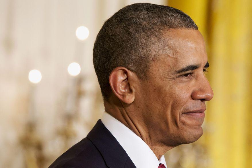 ** FILE ** President Obama. (AP Photo/Jacquelyn Martin)