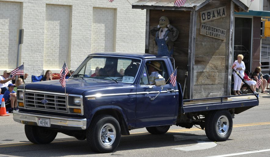 "A float with the words ""Obama Presidential Library"" is seen during the Fourth of July parade in downtown Norfolk, Neb., Friday morning, July 4, 2014. The float has received criticism from  a city councilman and the Nebraska Democratic Party, and others. (AP PHOTO/NORFOLK DAILY NEWS/Darin Epperly)"