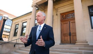 U.S. Sen. Ron Johnson holds a news conference on the steps of Wisconsin Eastern District Federal Courthouse Monday, July 7, 2014 in Green Bay, Wis. (AP Photo/The Green Bay Press-Gazette, Jim Matthews) ** FILE **