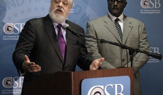 **FILE** Rafael Moure-Eraso (left), chairman of the U.S. Chemical Safety Board, speaks Jan. 5, 2012, in Nashville, Tenn., about a CSB report regarding three accidents over the first five months of 2011 at the Hoeganaes Corp. plant in Gallatin, Tenn. The report said Hoeganaes Corp. officials were aware that the iron dust it created could explode but did little to lessen the dangers. At right is Johnnie Banks, the U.S. Chemical Safety Board investigator-in-charge for the case. (Associated Press)