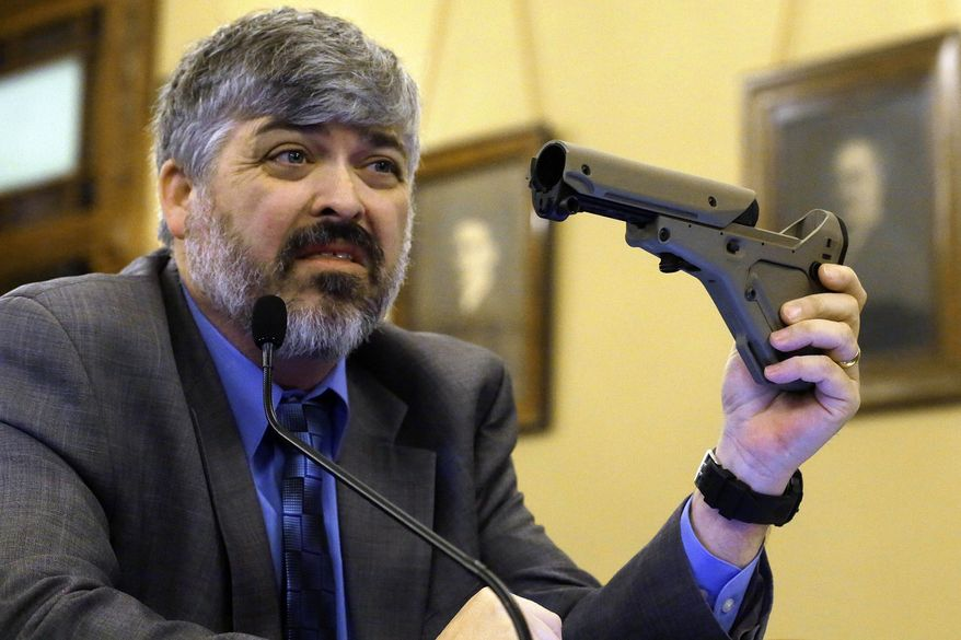 **FILE** Todd Vandermyde with the NRA shows off a gun butt stock during a House Committee hearing on assault weapons at the Illinois State Capitol in Springfield in February 2013. (Associated Press)