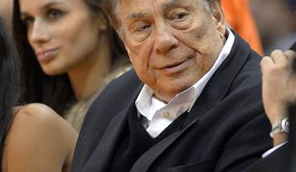 FILE - In this Oct. 25, 2013, file photo, Los Angeles Clippers owner Donald Sterling attends a Clippers game against the Sacramento Kings in Los Angeles. With the potentially record-breaking $2 billion sale of the Los Angeles Clippers hanging in the balance, a trial beginning Monday, July 7, 2014 will focus on whether Donald Sterling's estranged wife had the authority under terms of a family trust to unilaterally negotiate the deal. (AP Photo/Mark J. Terrill, File)