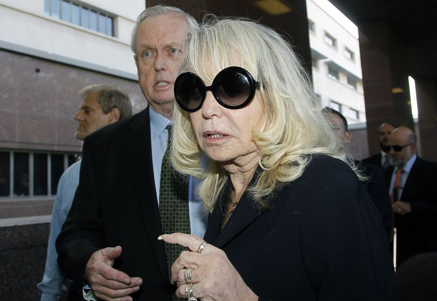 Shelly Sterling, the estranged wife of Los Angeles Clippers owner Donald Sterling, arrives at a Los Angeles courthouse with her attorney Pierce O' Donnell, Monday, July 7, 2014. With the potentially record-breaking $2 billion sale of the Clippers hanging in the balance, a trial beginning Monday will focus on Shelly Sterling had the authority under terms of a family trust to unilaterally negotiate the deal.  (AP Photo/Nick Ut)