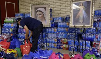 ** FILE ** In this June 20, 2014, photo, donated items for immigrant families who have crossed the U.S.-Mexico border illegally are arranged at the Sacred Heart Catholic Church in McAllen, Texas. (AP Photo/Eric Gay)