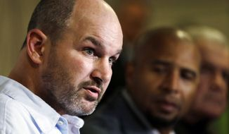 FILE - In this April 9, 2013 file photo, former NFL player Kevin Turner, left,  speaks during a news conference in Philadelphia, as former players Dorsey Levens, center, and Bill Bergey listen. The NFL agreed Wednesday, June 25, 2014, to remove a $675 million cap on damages from thousands of concussion-related claims after a federal judge questioned whether there would be enough money to cover as many as 20,000 retired players. The plaintiffs include Kevin Turner, who played for the Philadelphia Eagles and New England Patriots and is now battling ALS. (AP Photo/Matt Rourke, File)