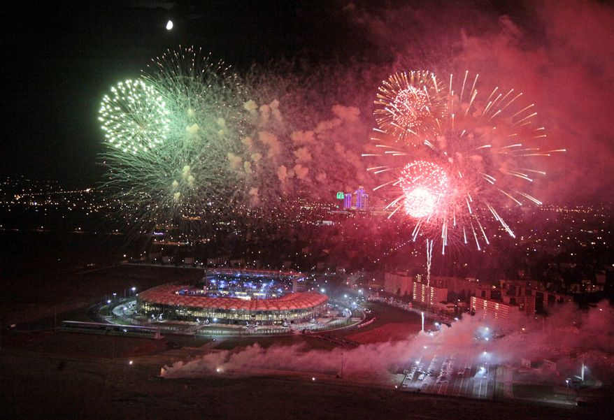 "Fireworks explode over the Ahmat Arena, after the WBA heavyweight boxing championship fight between Uzbekistan's Ruslan Chagaev and Fres Oquendo of the United States, in Grozny, Russia, Monday, July 7, 2014. Former WBA heavyweight champion Chagaev became a two-time champ, as he won a 12-round majority verdict over Fres Oquendo to pick up the ""regular"" WBA strap. (AP Photo/Musa Sadulayev)"
