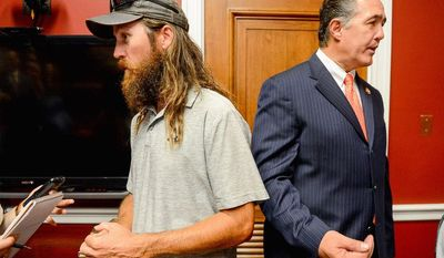 Jase Robertson, left, of the television show 'Duck Dynasty,' was on the Hill with her daughter Mia to visit with Rep. Frank. Both Rep. Frank and Mia have had cleft palate surgery.  (Andrew Harnik/The Washington Times)