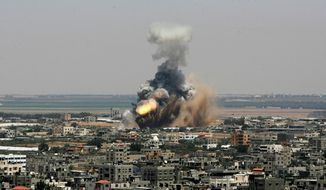 "Israeli missile strikes in Gaza on Tuesday could be the start of a long-term offensive against the Hamas-ruled territory. Palestinian President Mahmoud Abbas appealed for calm, and President Obama wrote an op-ed calling for a ""comprehensive negotiated settlement."" (Associated Press)"