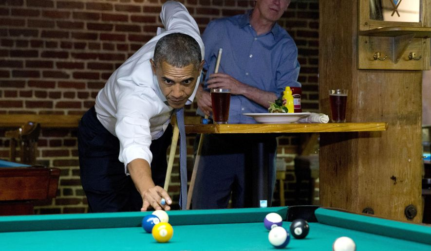 President Barack Obama plays pool at Wynkoop Brewing Co. with Colorado Gov. John Hickenlooper, rear, on Tuesday, July 8, 2014, in Denver. (AP Photo/Jacquelyn Martin)