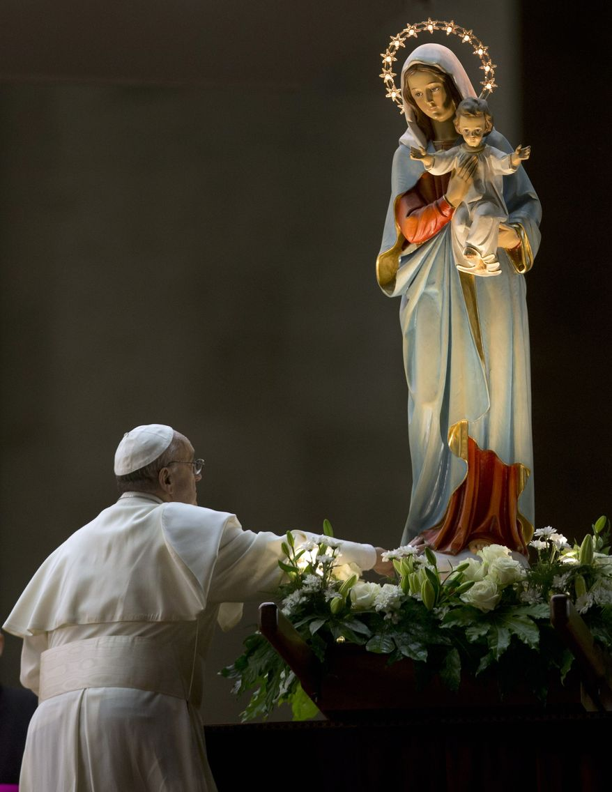 Pope Francis pays homage to a statue of the Virgin Mary during a ceremony to mark the closure of the month dedicated to the Virgin Mary in St. Peter's Square at the Vatican on May 31, 2013. (Associated Press)