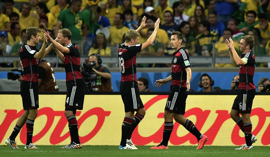 Germany's Miroslav Klose, 2nd right, celebrates after scoring his side's second goal during the World Cup semifinal soccer match between Brazil and Germany at the Mineirao Stadium in Belo Horizonte, Brazil, Tuesday, July 8, 2014. (AP Photo/Martin Meissner)