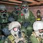 Soldiers in eastern Saudi Arabia with the U.S. Army's 7th Corps wear gas masks and chemical suits just after U.S. planes started bombing Iraq on Jan. 18, 1991, during the Persian Gulf War. (Associated Press/File)