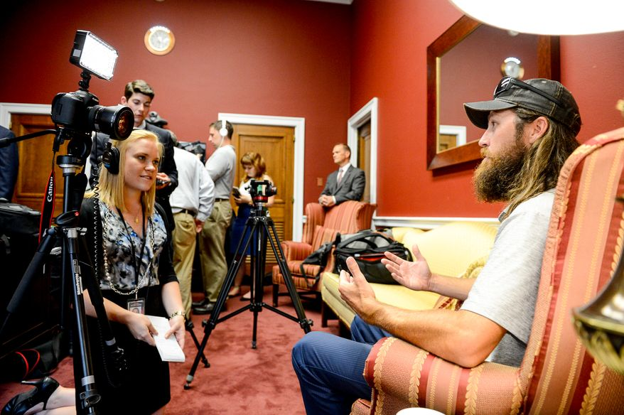 Jase Robertson, right, of the television show Duck Dynasty speaks to reporters at the Capitol Hill Office of Congressman Trent Franks (R-Ariz.), Washington, D.C., Tuesday, July 8, 2014. Robertson was on the hill with his daughter Mia to visit with Rep. Frank. Both Rep. Frank and Mia have had cleft palate surgery, and the Robertson family has started the Mia Moo Fund, a non-profit organization that is dedicated to raising awareness and funds towards research, treatments and causes of cleft lip & palate. (Andrew Harnik/The Washington Times)