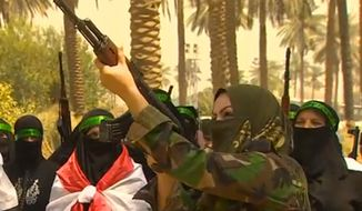 ** FILE ** The Badr Brigade, a Shiite militia comprised of 10,000 members, is teaching women basic marksmanship in the event that ISIL terrorists converge on Baghdad. (Image: CNN screenshot)