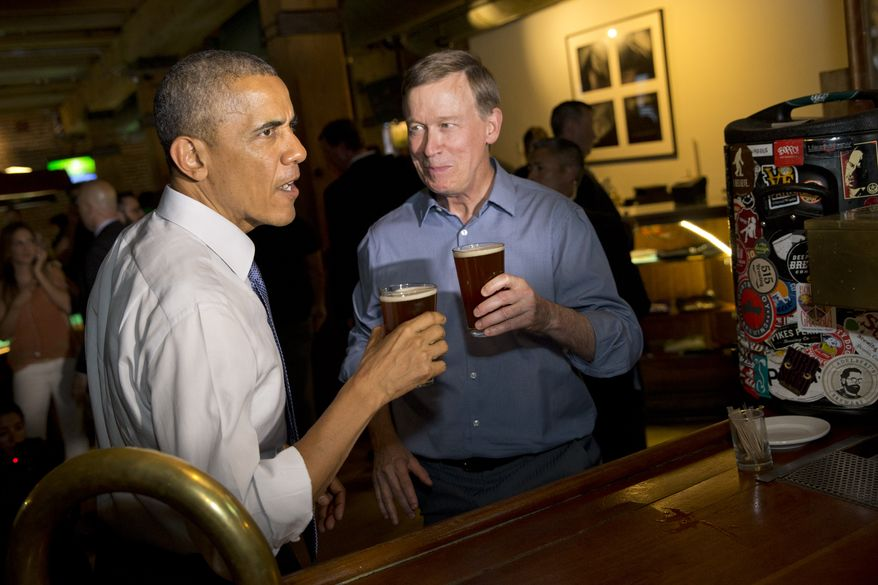 President Barack Obama has a beer at Wynkoop Brewing Co. with Colorado Gov. John Hickenlooper on Tuesday, July 8, 2014, in Denver. Obama is expected to attend a fundraiser and speak about the economy in Denver on Wednesday. (AP Photo/Jacquelyn Martin)
