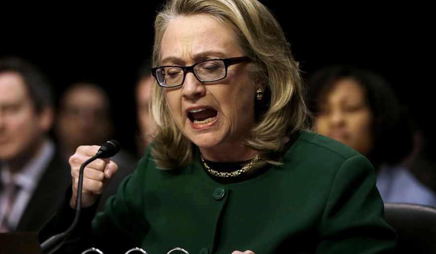 In this Jan. 23, 2013 photo, then-U.S. Secretary of State Hillary Rodham Clinton pounds her fist as she testifies on Capitol Hill in Washington at the Senate (AP Photo/Pablo Martinez Monsivais, File)