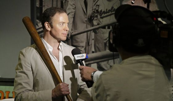 Goldin Auctions President Ken Goldin holds a baseball bat that Babe Ruth used early in his career, Wednesday, July 9, 2014, in Baltimore, as he is interviewed during a media preview of sports memorabilia slated for auction to mark the 100th anniversary of Ruth's major league debut. (AP Photo/Patrick Semansky) ** FILE **