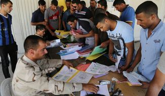 Iraqis sign up for military service to help battle an al Qaeda-inspired militant army intent on capturing Baghdad International Airport and eventually the capital itself. (Associated Press)