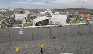 "The ""C"" tank farm is shown during a media tour of the Hanford Nuclear Reservation Wednesday, July 9, 2014 near Richland, Wash. Officials said Wednesday that 12,000 air samples taken at Hanford this year after more than three dozen workers reported being sickened by chemical vapors have failed to find a cause for the problem. Journalists were only allowed to visit the normally bustling tank farm worksite during a lunch break when only two workers were present. (AP Photo/Ted S. Warren)"