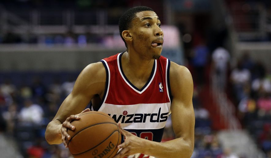 Washington Wizards forward Otto Porter Jr. (22) looks to pass in the second half of an NBA basketball game against the Miami Heat, Monday, April 14, 2014, in Washington. The Wizards won 114-93. (AP Photo/Alex Brandon)