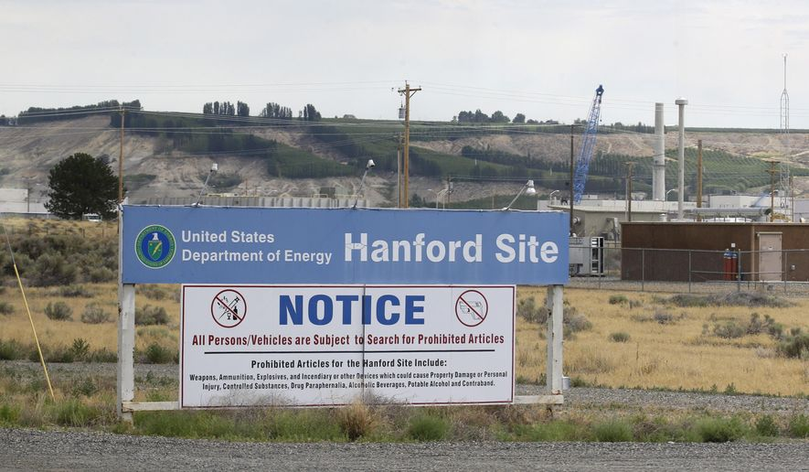 A sign informs visitors of prohibited items on the Hanford Nuclear Reservation Wednesday, July 9, 2014 near Richland, Wash. Officials said Wednesday that 12,000 air samples taken at Hanford this year after more than three dozen workers reported being sickened by chemical vapors have failed to find a cause for the problem. (AP Photo/Ted S. Warren)