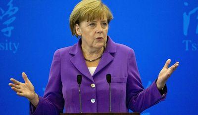 German Chancellor Angela Merkel delivers a speech at Tsinghua University in Beijing, China, Tuesday, July 8, 2014. (AP Photo/Ng Han Guan)