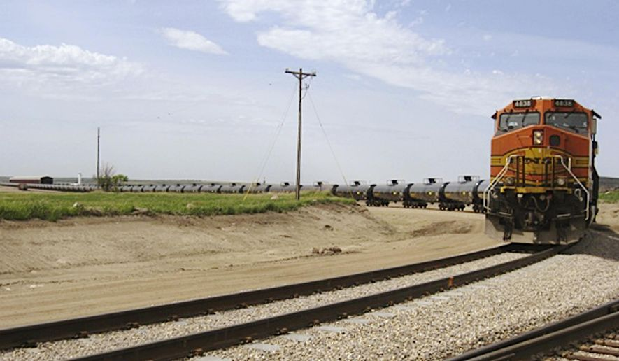 FILE - In this June 5, 2012 file photo provided by Rangeland Energy, LLC, a train leaves the company's crude oil loading terminal near Epping, ND. BNSF Railway is regularly hauling three trains a week loaded with crude oil through the Sioux Falls area, but those are the only shipments of crude from North Dakota's Bakken region crossing the state, according to records released by the South Dakota Department of Environment and Natural Resources Wednesday, July 9, 2014. (AP Photo/Courtesy of Rangeland Energy, LLC, File)