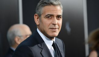"** FILE ** In this Oct. 1, 2013, file photo actor George Clooney attends the premiere of ""Gravity"" at the AMC Lincoln Square Theaters, in New York. George Clooney has chastised a British newspaper over an article claiming his fiancee's mother disapproves of the impending marriage for religious reasons. Clooney said that the claims about his future mother-in-law Baria Alamuddin were untrue and irresponsible. (Photo by Evan Agostini/Invision/AP, File)"