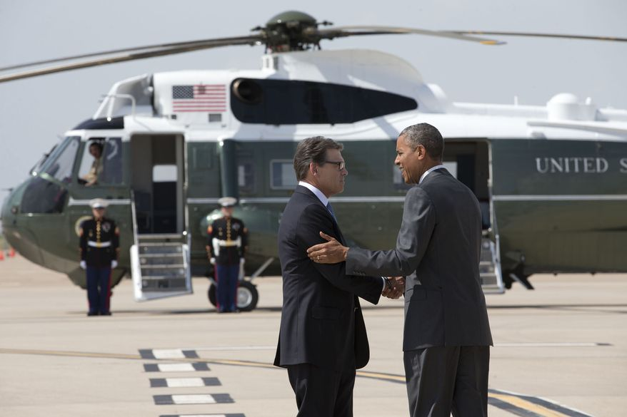 President Barack Obama is greeted by Texas Gov. Rick Perry as he arrives at Dallas/Fort Worth International Airport, Wednesday, July 9, 2014. The president is expected to attend a meeting on immigration, (AP Photo/Jacquelyn Martin)
