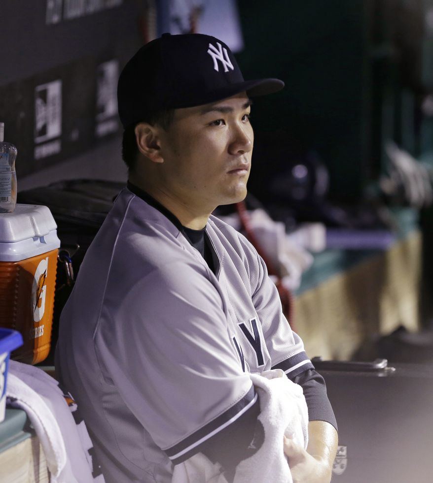 New York Yankees starting pitcher Masahiro Tanaka watches from the dugout after leaving the game in the seventh inning of a baseball game against the Cleveland Indians Tuesday, July 8, 2014, in Cleveland. Tanaka pitched 6 2/3 innings and gave up 10 hits and five runs. (AP Photo/Tony Dejak)