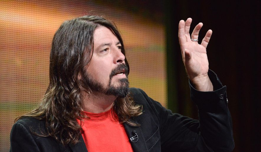 """Dave Grohl speaks onstage during the """"Foo Fighters: Sonic Highways"""" segment of the BBC America 2014 Summer TCA on Thursday, July 10, 2014, in Beverly Hills, Calif. (Photo by Richard Shotwell/Invision/AP)"""