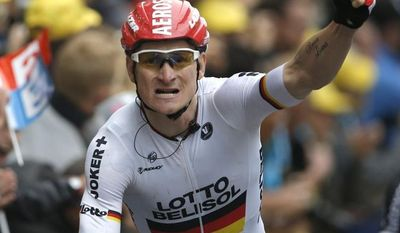 Germany's Andre Greipel crosses the finish line to win the sixth stage of the Tour de France cycling race over 194 kilometers (120.5 miles) with start in Arras and finish in Reims, France, Thursday, July 10, 2014. (AP Photo/Peter Dejong)