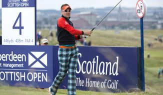 England's Ian Poulter tees off at the 4th during day one of the Scottish Open at Royal Aberdeen golf course, Aberdeen Scotland Thursday July 10, 2014. (AP Photo/Kenny Smith/PA) UNITED KINGDOM OUT