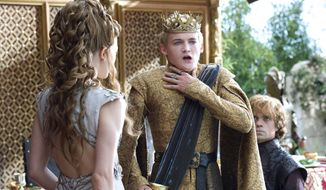 """This image released by HBO shows Natalie Dormer, left, Jack Gleeson, Peter Dinklage, right in a scene from """"Game of Thrones."""" The series garnered 19 Emmy Award nominations on Thursday, July 10, 2014, including one for best drama series. (AP Photo/HBO, Macall B. Polay)"""