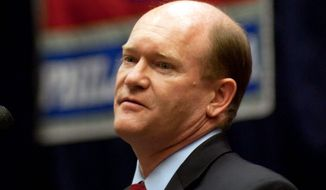 Sen. Chris Coons, Delaware Democrat and author of a proposal that would repeal parts of the First Amendment, said he is looking to restore balance. (Associated Press)