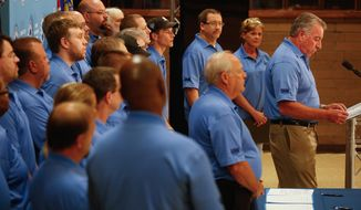 UAW Secretary-Treasurer Gary Casteel (right) stands with Volkswagen employees at a news conference Thursday in Chattanooga, Tenn., at which Mr. Casteel announced the formation of a new local of the United Auto Workers' union, with the blessing of the German automaker's officials. (Associated Press)