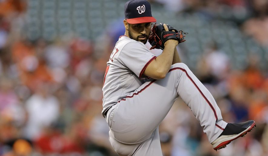 Washington Nationals starting pitcher Gio Gonzalez winds up for a pitch to the Baltimore Orioles in the first inning of an interleague baseball game, Thursday, July 10, 2014, in Baltimore. (AP Photo/Patrick Semansky)
