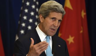 U.S. Secretary of State John Kerry speaks at a press conference following the end of talks at the U.S.-China Strategic and Economic Dialogue, in Beijing on Thursday, July 10, 2014. (AP Photo/Greg Baker, Pool)