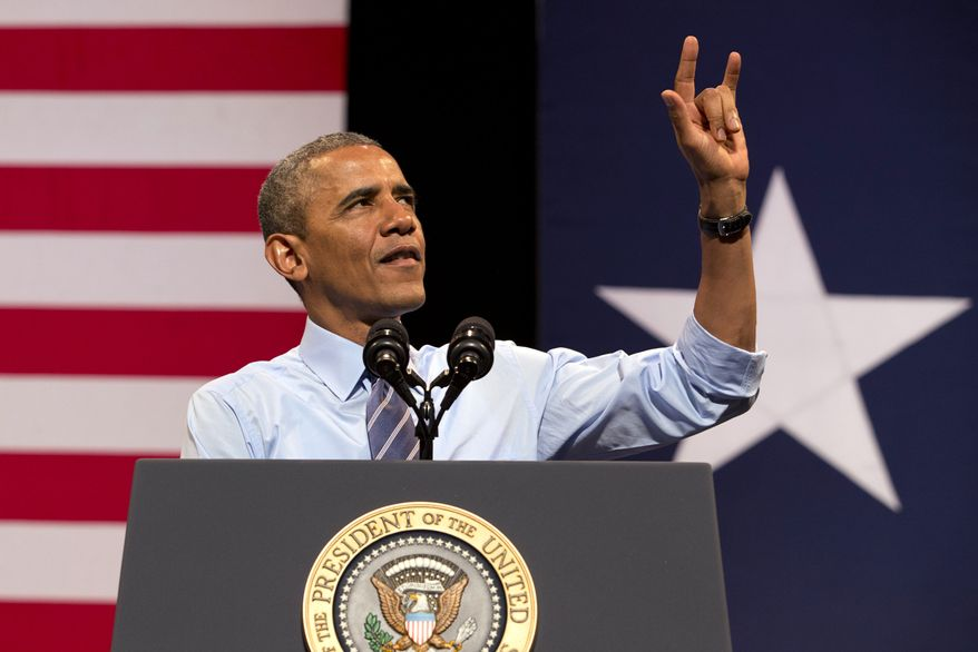 President Barack Obama gestures as he speaks at the Paramount Theatre in Austin, Texas, Thursday, July 10, 2014, about the economy. Austin is the final leg in his three city trip before returning to Washington. (AP Photo/Jacquelyn Martin)