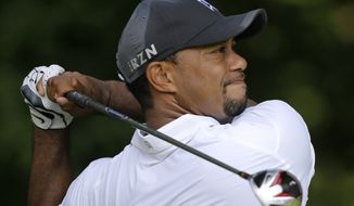 Tiger Woods tees off on the 14th hole during the second round of the Quicken Loans National PGA golf tournament, Friday, June 27, 2014, in Bethesda, Md. (AP Photo/Patrick Semansky)