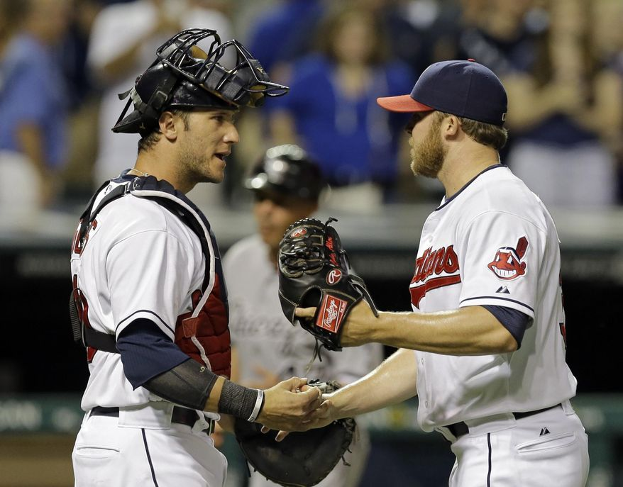 Cleveland Indians catcher Yan Gomes, left, congratulates relief pitcher Cody Allen after the final out in a 7-4 win over the Chicago White Sox in a baseball game Friday, July 11, 2014, in Cleveland. (AP Photo/Mark Duncan)