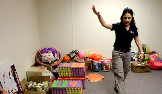 "Barbara Gonzalez, public information officer for Immigration and Customs Enforcement, shows a play room in an area where immigrant families are housed at the Artesia Residential Detention Facility inside the Federal Law Enforcement Center in Artesia, N.M. on Friday, July 11, 2014. U.S. Homeland Security Secretary Jeh Johnson visited the facility Friday and warned immigrants that ""we will send you back"" if they try crossing into the country. (AP Photo/Pool, El Paso Times, Rudy Gutierrez)"